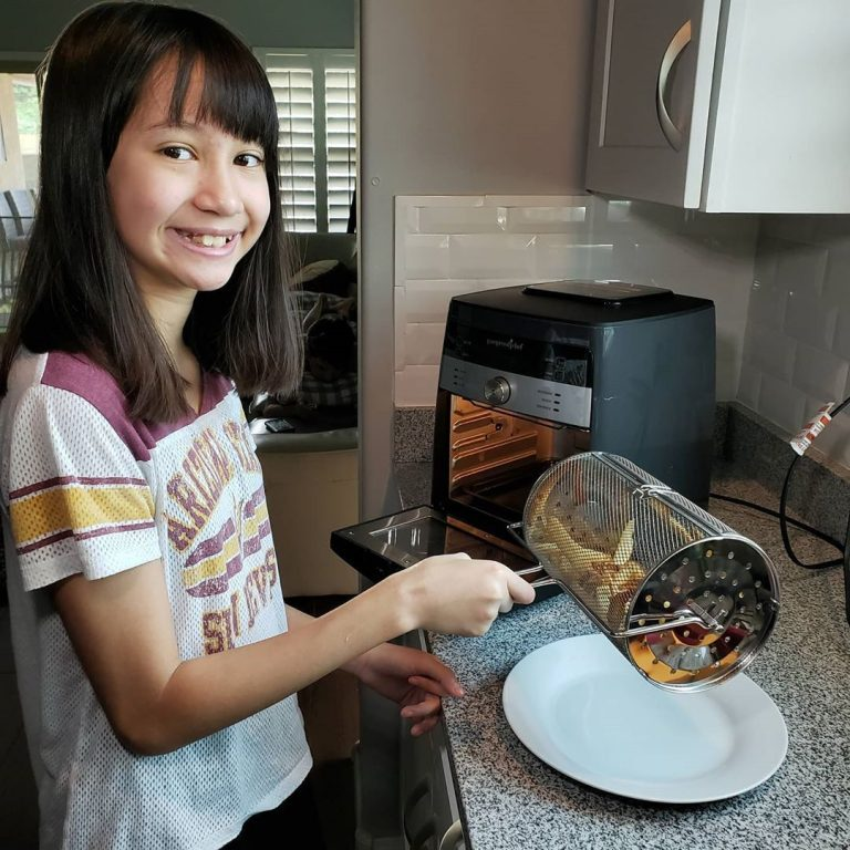 Girl Using Air Fryer