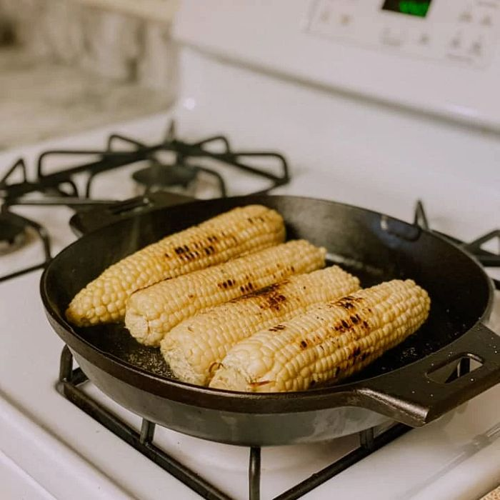 Corn in a cast iron pan on a stove